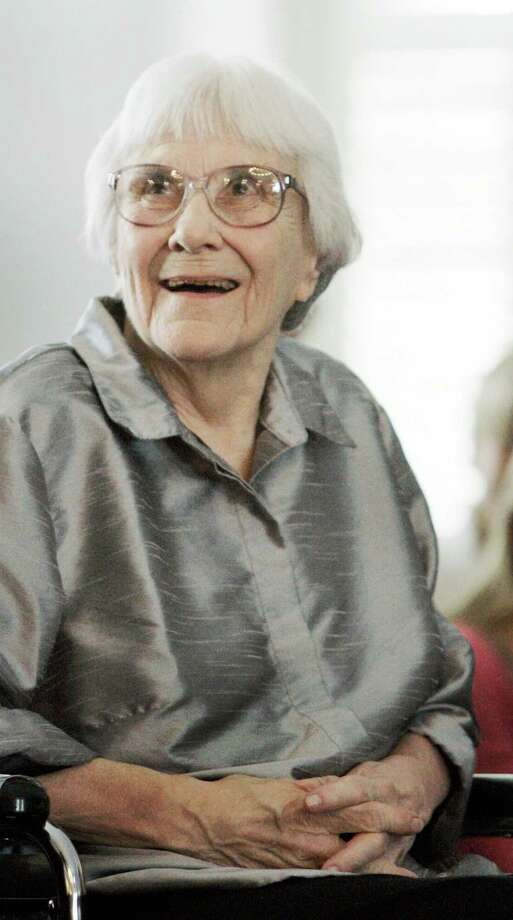 """FILE - In this Aug. 20, 2007, file photo, author Harper Lee smiles during a ceremony honoring the four new members of the Alabama Academy of Honor at the Capitol in Montgomery, Ala. """"To Kill a Mockingbird"""" will be made available as an e-book and digital audiobook in July 2014, filling one of the biggest gaps in the electronic library. Author Harper Lee said in a rare public statement Monday, April 28, 2014, issued through HarperCollins Publishers, that while she still favored """"dusty"""" books she had signed on for making """"Mockingbird"""" available to a """"new generation."""" (AP Photo/Rob Carr, File) Photo: Rob Carr, STF / AP"""