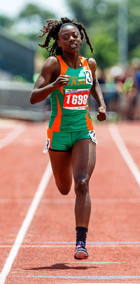 Sam Houston's Tashonna Williams approaches the finish line during UIL state in 2012. She's back at state this year. / Express-News 2012