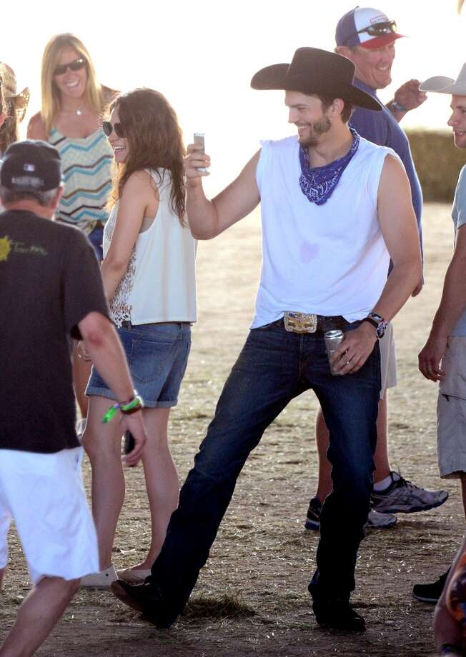 Actors Mila Kunis and Ashton Kutcher seen during day 3 of 2014 Stagecoach: California's Country Music Festival at the Empire Polo Club on April 27, 2014 in Indio, California. Photo: Frazer Harrison, Getty Images For Stagecoach
