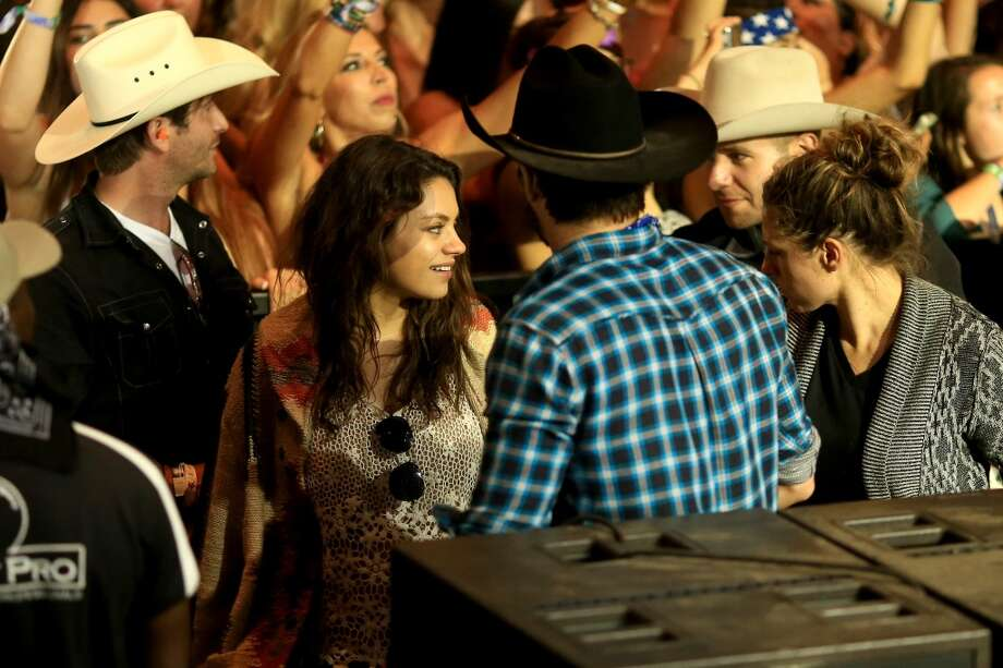 Actors Ashton Kutcher (R) and Mila Kunis during day 3 of 2014 Stagecoach: California's Country Music Festival at the Empire Polo Club on April 27, 2014 in Indio, California. Photo: Christopher Polk, Getty Images For Stagecoach
