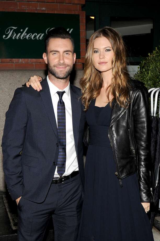 "Musician Adam Levine (L) and model Behati Prinsloo attend the CHANEL Dinner in honor of the 2014 Tribeca Film Festival closing night film ""Begin Again"" at Tribeca Grill on April 26, 2014 in New York City. Photo: Bryan Bedder, Getty Images For CHANEL"