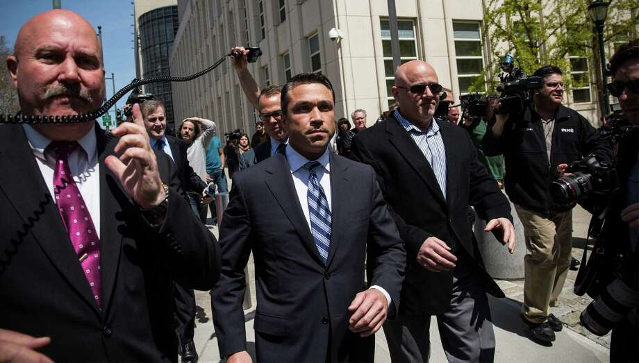 U.S. Rep. Michael Grimm, R-N.Y., (at center), walks out of Brooklyn Federal Court after being indicted on 20 counts Monday in Brooklyn. Grimm's indictments include conspiring to defraud the United States. Photo: Andrew Burton, Staff / 2014 Getty Images