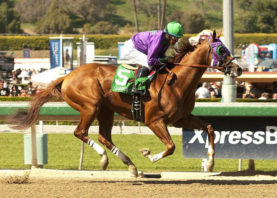 Jockey Victor Espinoza rides California Chrome to victory at the Santa Anita Derby earlier this month. Photo: Associated Press