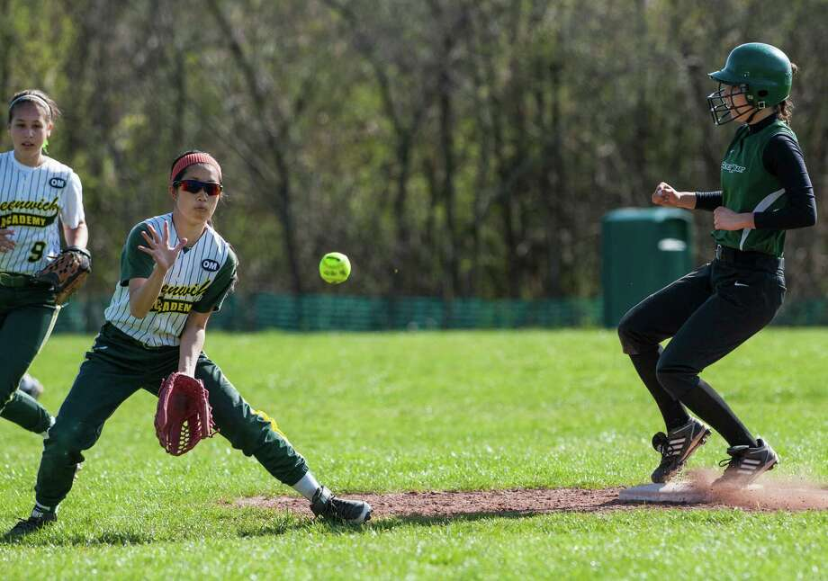 Greenwich Academy shortstop Hiromi Terai doesn't get the ball in time to get Convent of the Sacred Heart's Christina Monaco out at second during a softball game played at Convent of the Sacred Heart, Greenwich, CT on Monday, April, 28th, 2014. Photo: Mark Conrad / Connecticut Post Freelance