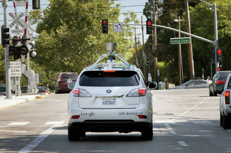 This Wednesday, April 23, 2014 photo provided by Google shows the Google driverless car navigating along a street in Mountain View, Calif. The director of Google's self-driving car project wrote in a blog post Monday, April 28, that development of the technology has entered a new stage: trying to master driving on city streets. Many times more complex than freeways, which the cars can now reliably navigate, city streets represent a huge challenge. (AP Photo/Google) ORG XMIT: LA101 Photo: HOEP / Google