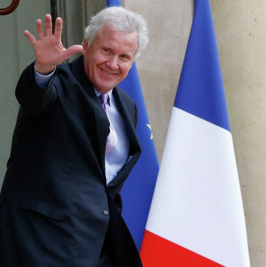 U.S. giant General Electric Co. CEO Jeffrey R. Immelt leaves the Elysee Palace after meeting with French President Francois Hollande in Paris, Monday, April 28, 2014. Officials close to talks on a proposed merger between Alstom and General Electric say France's president is open to the idea, despite a delay imposed by one of his top finance officials. President Francois Hollande is meeting three CEOs in an all-out effort to orchestrate a deal for Alstom and keep the engineering company firmly rooted at home. (AP Photo/Michel Euler) ORG XMIT: MEU107 Photo: Michel Euler / AP