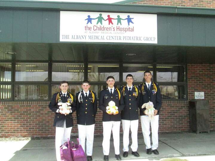 Christian Brothers Academy students deliver Easter gifts on Holy Thursday. From left, Evan Carey, 12
