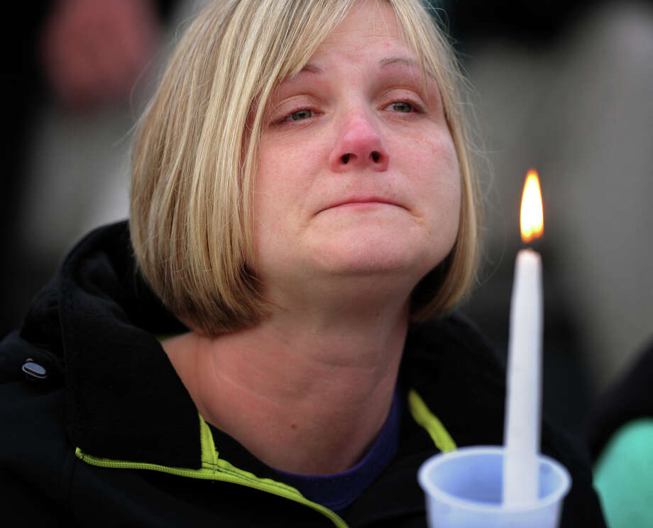 A mourner attends the vigil in honor of slain student Maren Sanchez at Jonathan Law High School in Milford, Conn. on Monday, April 28, 2014. Photo: Brian A. Pounds / Connecticut Post