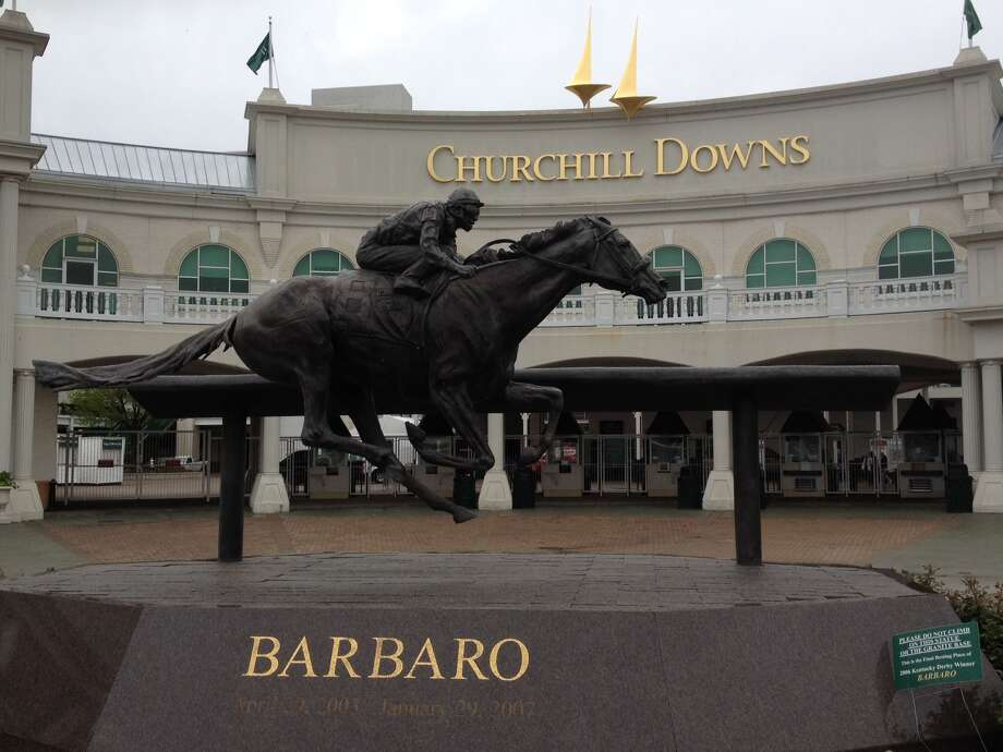 A photo of the popular statue of the ill-fated 2006 Kentucky Derby winner Barbaro, which stands guard in front of Gate One at Churchill. (Tim Wilkin / Times Union)