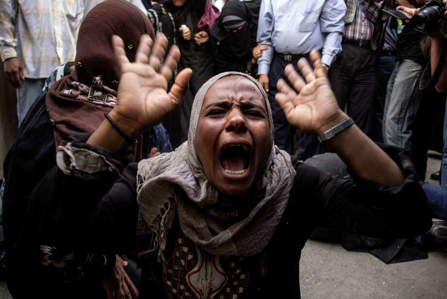 An Egyptian woman screams after a judge sentenced to death 683 alleged supporters of the country's ousted Islamist president over acts of violence and the murder of policemen in the latest mass trial in the southern city of Minya, Egypt, Monday, April 28, 2014. Under the law, Monday's verdicts in Minya have to be referred to Egypt's Grand Mufti, the top Islamic official, said one of the attorneys, Ahmed Hefni. (AP Photo/Roger Anis, El Shorouk Newspaper) EGYPT OUT Photo: Roger Anis, STR / El Shorouk Newspaper