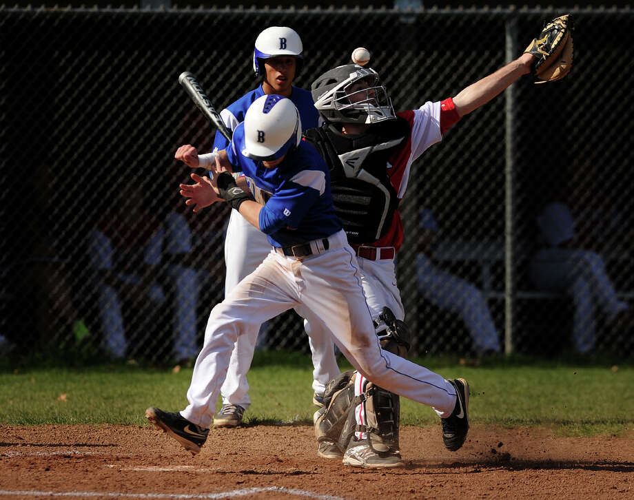 Bunnell's Cameron Belliveau scores on a double steal as the throw gets away from Masuk catcher Matt Romaniello in the first inning of their baseball game at Masuk High School in Monroe, Conn. on Monday, April 28, 2014. Photo: Brian A. Pounds / Connecticut Post