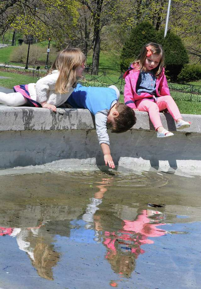Isla Platek, 4, left, Chase Messier, 3, center, and Bria Babin, 3, right, all of Slingerlands, play in the water at the Mosses statue and fountain Monday, April 28, 2014, at Washington Park on in Albany, N.Y. (Lori Van Buren / Times Union) Photo: Lori Van Buren