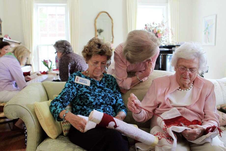 Shirley Hopkins, Gerry Eversole and former first lady Barbara Bush stitch kneelers. Photo: Mayra Beltran, Staff / © 2014 Houston Chronicle