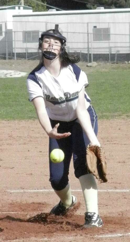 Notre Dame-Fairfield freshman Shelby Nolan unleashes a pitch against Oxford on Monday, April 28 in an SWC Patriot Division softball game in Fairfield. Oxford won 5-1 and Nolan, ordinarily the Lancers' second baseman, made her first career start. Photo: Reid L. Walmark / Fairfield Citizen