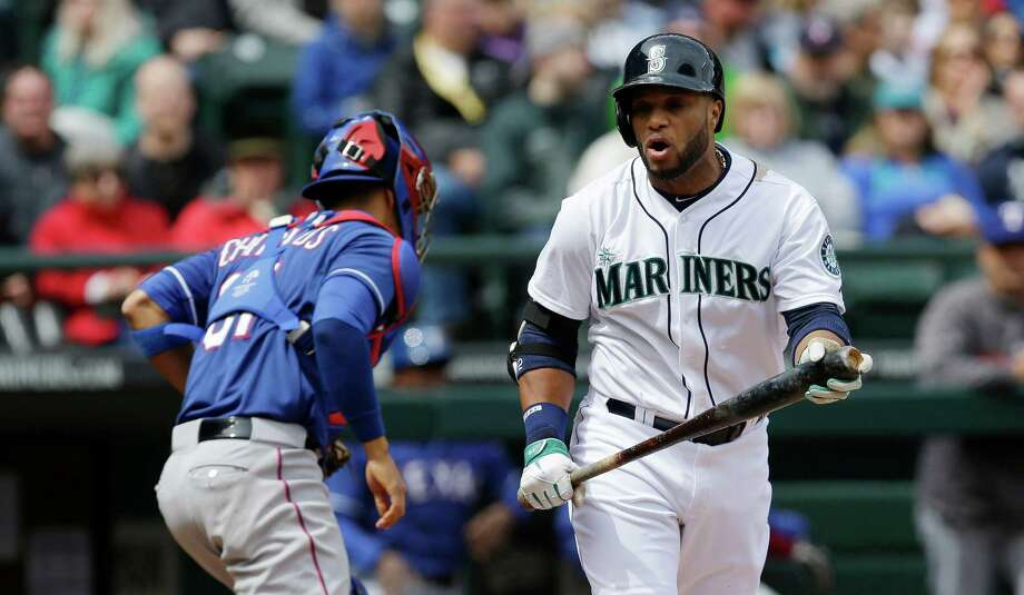 Seattle Mariners' Robinson Cano, right, reacts afterstriking out swinging to to end the first inning as Texas Rangers catcher Robinson Chirinos, left, heads off the field during a baseball game on Sunday, April 27, 2014, in Seattle. (AP Photo/Ted S. Warren) ORG XMIT: WATW108 Photo: Ted S. Warren / AP