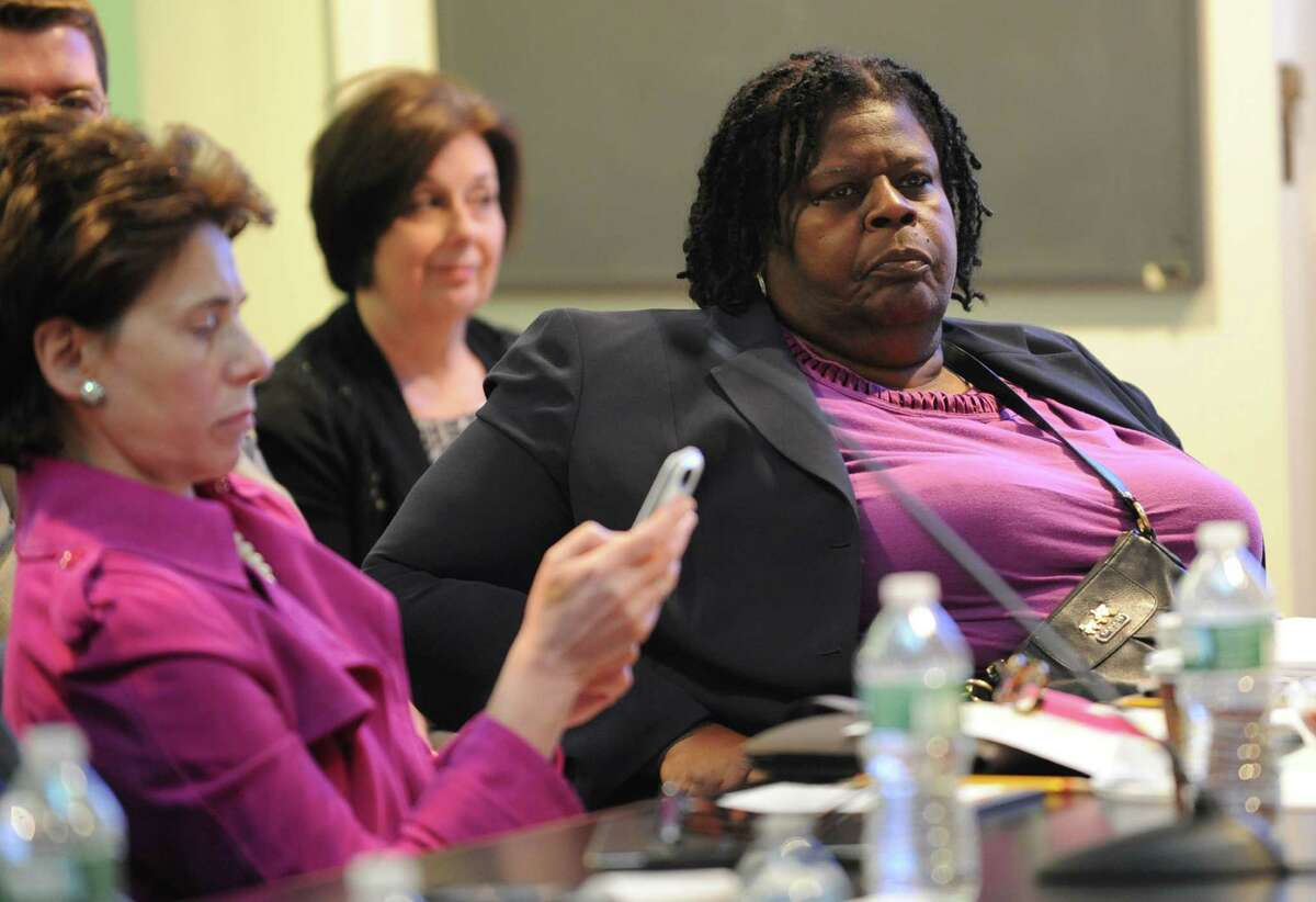 New Regents member Josephine Victoria Finn, right, listens as the New York State State Board of Regents holds a meeting on different issues such as common core and classifying cheerleading in public schools a competitive sport Monday, April 28, 2014, at the State Education Building in Albany, N.Y. (Lori Van Buren / Times Union)