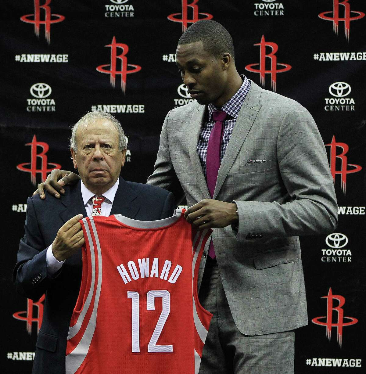Houston Rockets owner Les Alexander holds Dwight Howard's jersey with Dwight Howard during the press conference and welcoming ceremony for Dwight Howard, Saturday, July 13, 2013, in Houston. ( Karen Warren / Houston Chronicle )