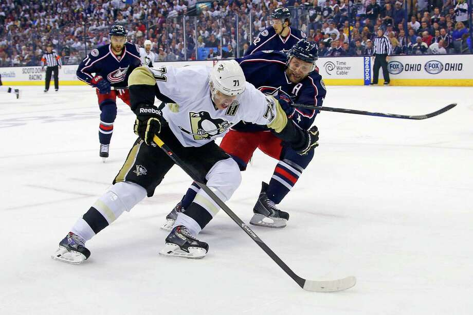 COLUMBUS, OH - APRIL 28:  Evgeni Malkin #71 of the Pittsburgh Penguins attempts to skate the puck past Jack Johnson #7 of the Columbus Blue Jackets during the first period of Game Six of the First Round of the 2014 NHL Stanley Cup Playoffs at Nationwide Arena on April 28, 2014 in Columbus, Ohio. (Photo by Kirk Irwin/Getty Images) ORG XMIT: 485353165 Photo: Kirk Irwin / 2014 Getty Images