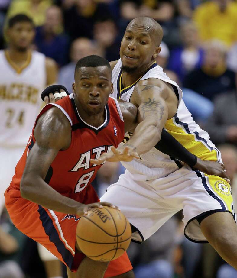 Atlanta Hawks' Shelvin Mack (8) is defended by Indiana Pacers' David West (21) during the second half in Game 5 of an opening-round NBA basketball playoff series Monday, April 28, 2014, in Indianapolis. Atlanta defeated Indiana 107-97. (AP Photo/Darron Cummings)  ORG XMIT: NAF1119 Photo: Darron Cummings / AP