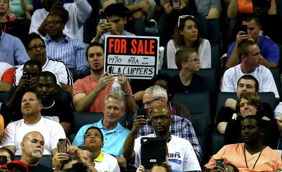 A fan in Charlotte gives an indication of how he wants the NBA to punish Donald Sterling. Photo: Streeter Lecka, Staff / 2014 Getty Images