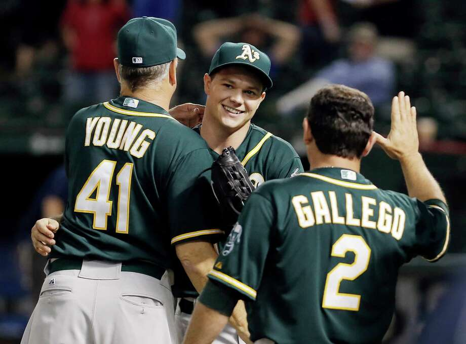 Oakland Athletics starting pitcher Sonny Gray, center, was all smiles after making life easy on his teammates with a three-hit shutout Monday night. Photo: Brandon Wade, FRE / FR168019 AP