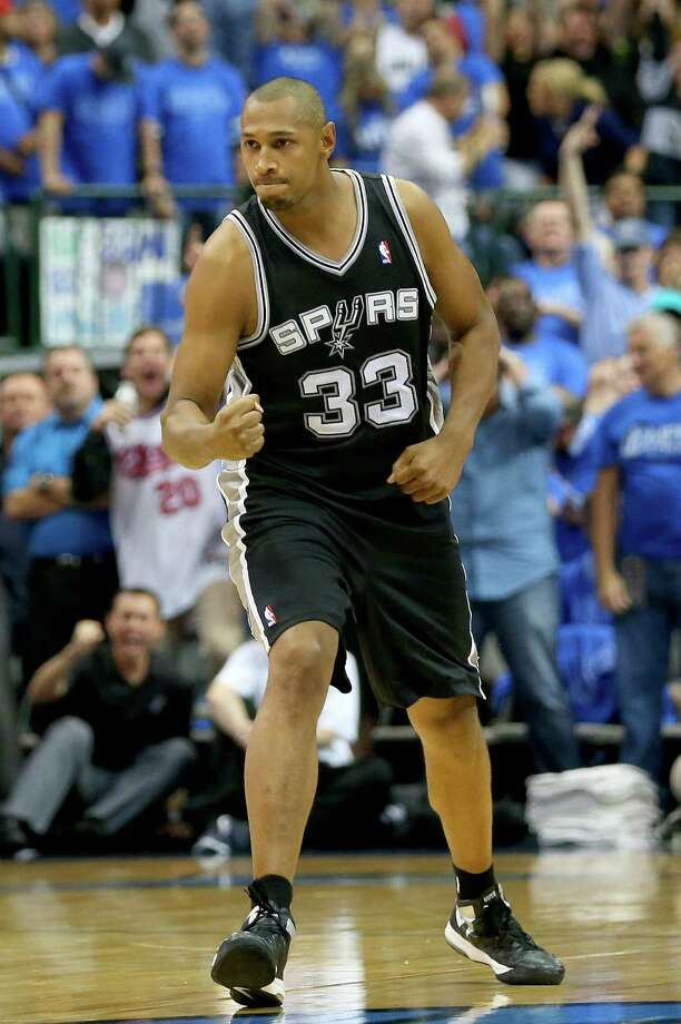 Forward Boris Diaw of the Spurs exults after hitting his tiebreaking 3-pointer. / 2014 Getty Images