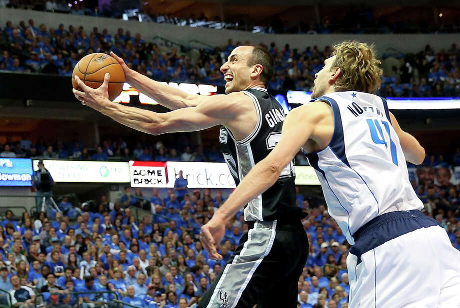 DALLAS, TX - APRIL 28:  Manu Ginobili #20 of the San Antonio Spurs takes a shot against Dirk Nowitzki #41 of the Dallas Mavericks in Game Four of the Western Conference Quarterfinals during the 2014 NBA Playoffs at American Airlines Center on April 28, 2014 in Dallas, Texas. NOTE TO USER: User expressly acknowledges and agrees that, by downloading and or using this photograph, User is consenting to the terms and conditions of the Getty Images License Agreement.  (Photo by Ronald Martinez/Getty Images) Photo: Getty Images / 2014 Getty Images