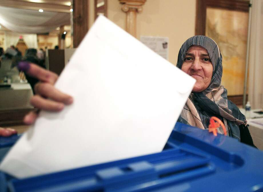 DEARBORN, MI - APRIL 28: A metro Detroit Iraqi casts her vote for elections being held in Iraq April 28, 2014 in Dearborn, Michigan. Approximately 9,000 candidates are running for 328 seats in the Iraqi Parliament. (Photo by Bill Pugliano/Getty Images) Photo: Bill Pugliano, Getty Images
