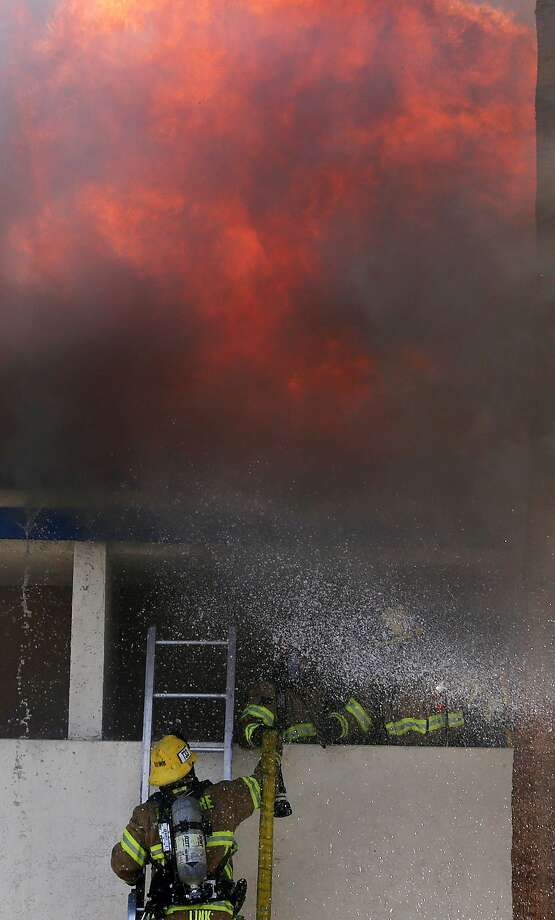 Valley firefighters battle an intense fire at the Fairfield Inn Marriott in Palm Desert, Calif., Monday, April 28, 2014. (AP Photo/The Desert Sun, Michael Snyder) Photo: Michael Snyder, Associated Press