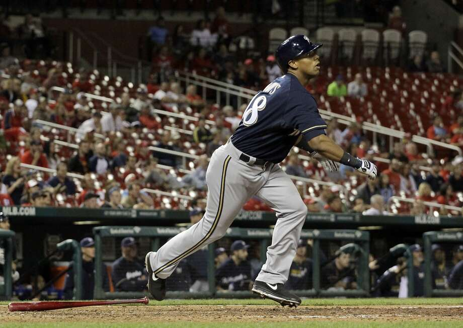 After striking out four times and also flying out with the bases loaded and two outs, Kris Davis hit a run-scoring triple to right off Seth Maness in the 12th inning to break a tie and set up the Milwaukee Brewers for a 5-3 victory in St. Louis. Photo: Jeff Roberson, Associated Press