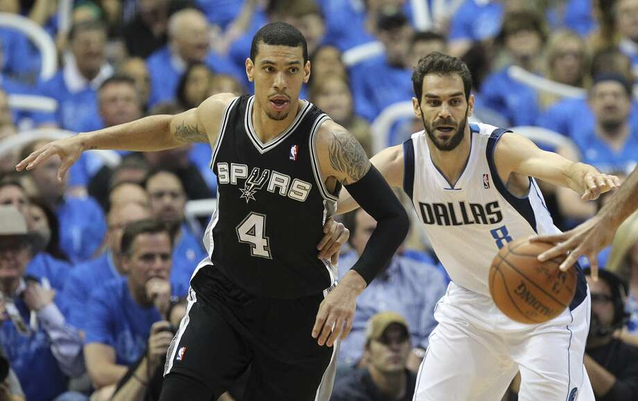 San Antonio Spurs' Danny Green is chased by Dallas Mavericks' Jose Calderon during the first half of game four in the first round of the Western Conference Playoffs at the American Airlines Center in Dallas, Monday, April 26, 2014. The Mavericks lead the series 2-1. Photo: Jerry Lara, San Antonio Express-News
