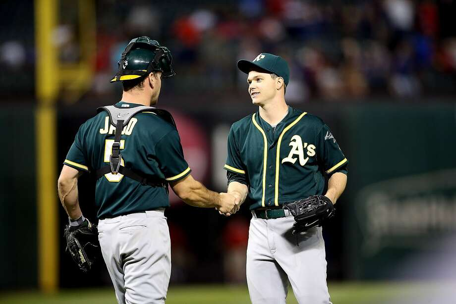 ARLINGTON, TX - APRIL 28: John Jaso #5 of the Oakland Athletics congratulates Sonny Gray #54 for shutting out the Texas Rangers at Globe Life Park in Arlington on April 28, 2014 in Arlington, Texas.  (Photo by Rick Yeatts/Getty Images) Photo: Rick Yeatts, Getty Images