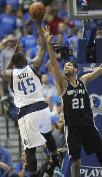 San Antonio Spurs' Tim Duncan tries to defend against Dallas Mavericks' DeJuan Blair during the second half of game four in the first round of the Western Conference Playoffs at the American Airlines Center in Dallas, Monday, April 28, 2014. The Spurs won 93-89 to tie the series 2-2. Photo: Jerry Lara, San Antonio Express-News