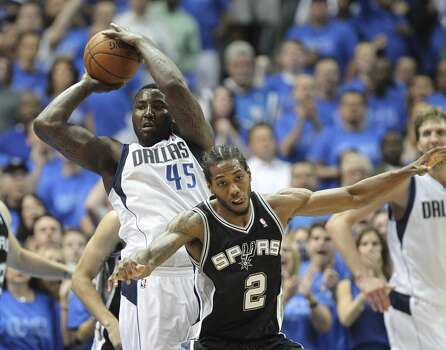 Dallas Mavericks' DeJuan Blair passes the ball over San Antonio Spurs' Kawhi Leonard during the second half of game four in the first round of the Western Conference Playoffs at the American Airlines Center in Dallas, Monday, April 28, 2014. The Spurs won 93-89 to tie the series 2-2. Photo: Jerry Lara, San Antonio Express-News