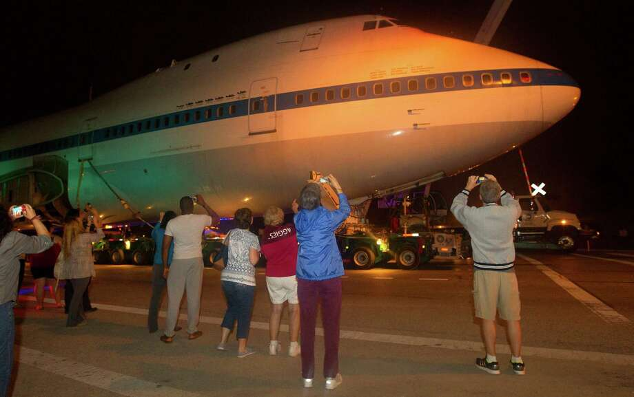 Onlookers watch as the NASA Shuttle Carrier Aircraft makes its way along from Ellington Field to Space Center Houston on Tuesday. Photo: Cody Duty, Houston Chronicle / © 2014 Houston Chronicle