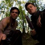 Eli Roth and Brad Pitt in Quentin Tarantino's 'Inglorious Basterds.'   If you still haven't seen it, watch it on an airplane.  Lots of action, but also quite talkie, with surprisingly long scenes.  One of the best movies of the last decade.