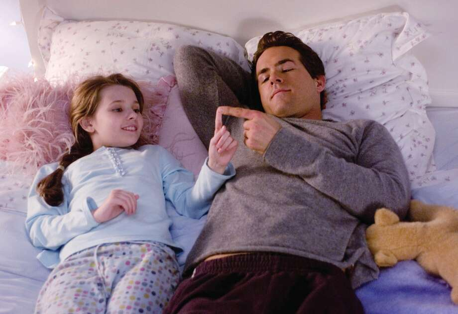 Ryan Reynolds with Abigail Breslin portrays in a scene from the film 'Definitely, Maybe.'  A rare sensitive romantic comedy about courtship from a man's viewpoint. Photo: Andrew Schwartz, AP