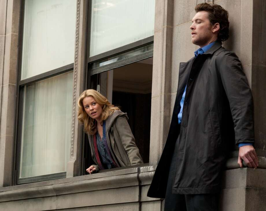 Elizabeth Banks and Sam Worthington are shown in a scene from 'Man on a Ledge.'  A good entertaining caper movie. Photo: Myles Aronowitz, Associated Press
