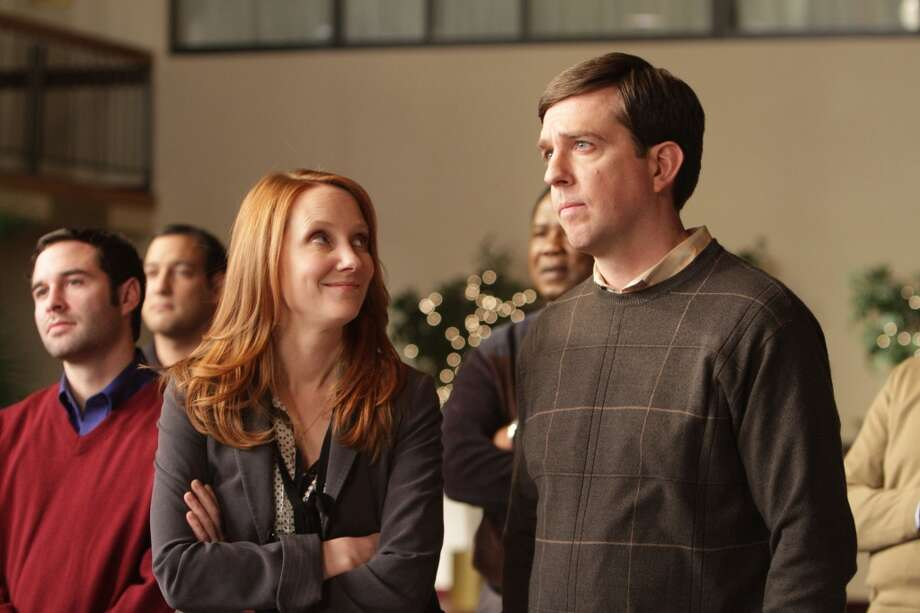 Anne Heche, left, and Ed Helms are shown in a scene from  'Cedar Rapids.'  Nice simple warm movie, easy to follow. Photo: Zade Rosenthal, AP
