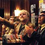 Philip Seymour Hoffman, center, and Nick Frost, right, are shown in a scene from 'Pirate Radio'