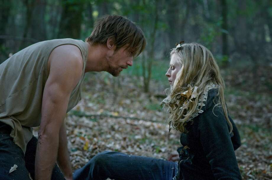 Brit Marling and Alexander Skarsgard in a scene from 'The East.' One of the best of 2013, a smart thriller. Photo: Myles Aronowitz, Associated Press