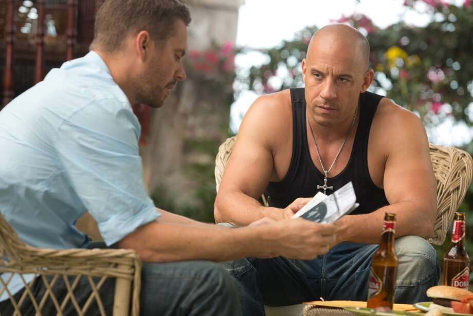 Vin Diesel and the late Paul Walker in 'Fast and Furious 6.'  Thoroughly silly and hard to resist. Photo: Universal Pictures 2013