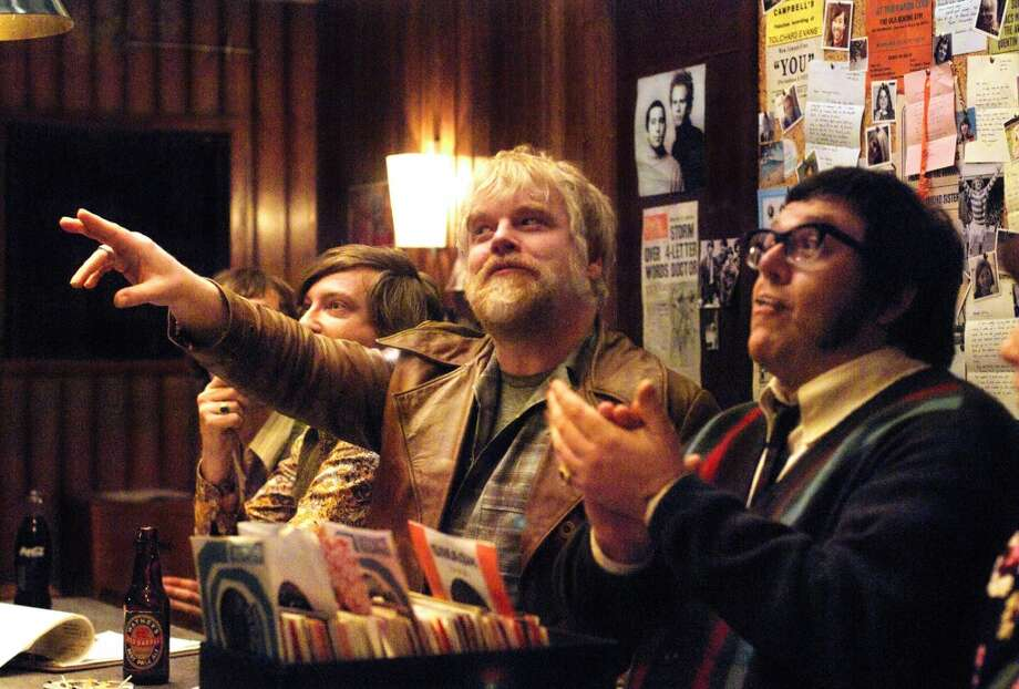 Philip Seymour Hoffman, center, and Nick Frost, right, are shown in a scene from 'Pirate Radio' Photo: Alex Bailey, AP