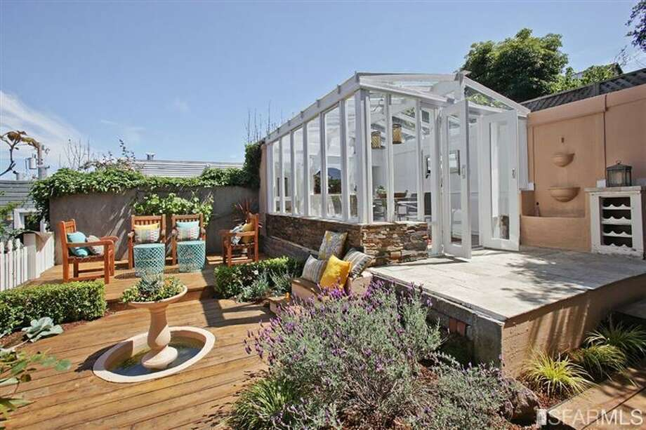 The backyard is well-designed for entertaining. Photo: MLS