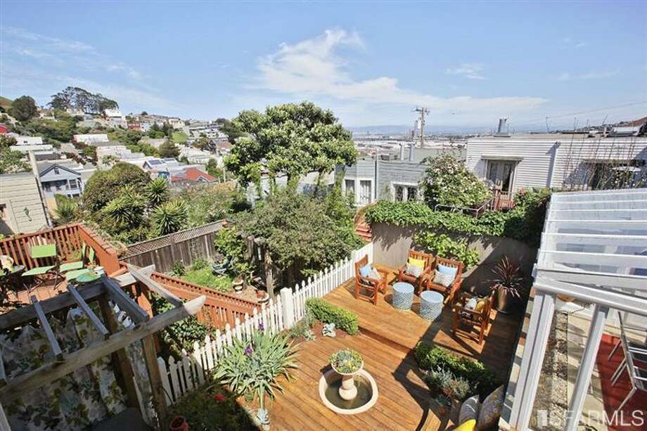 Views of the bay and Bernal Hill from the back of the house. Photo: MLS
