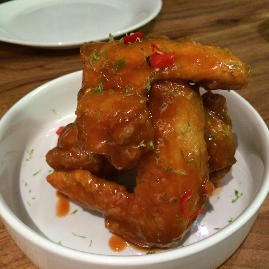 "Kin Khao: These ""pretty hot wings"" offer a Thai take, with a tamarind and sriracha glaze"