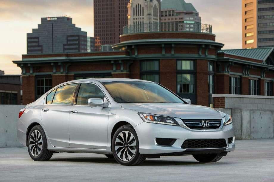 5. 2014 Honda Accord HybridMSRP: Starting at $29,155Source: AutoTrader Photo: COURTESY, COURTESY OF HONDA / COURTESY OF HONDA