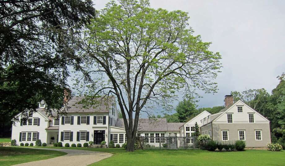 The estate at 4 Wee Burn Lane in Darien, designed by Darien-based builder Bo Malpass, is set on more than 2 acres of overlook land trust meadows. It is on the market for $5,995,000. Photo: Contributed Photo, Contributed / Darien News