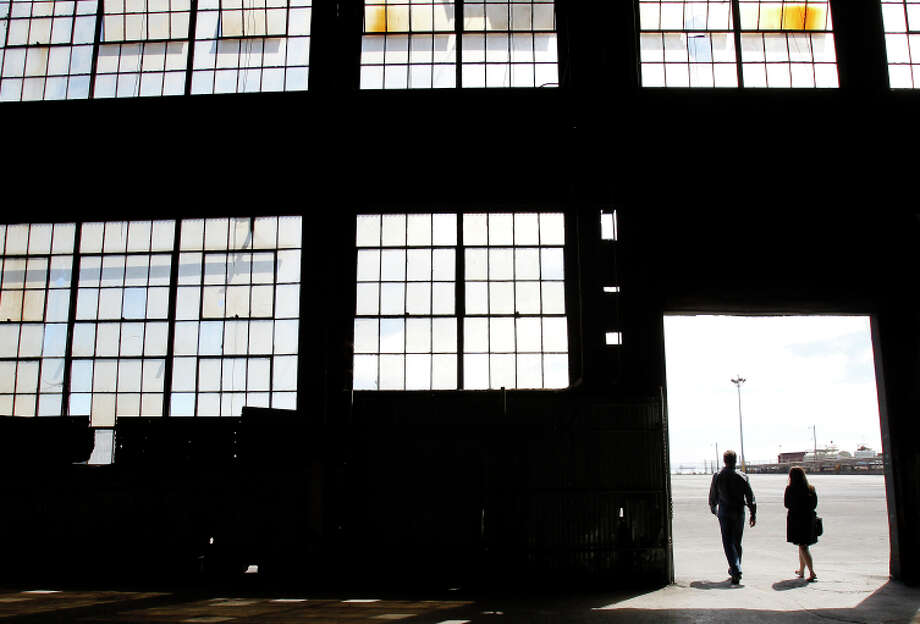 Developer Forest City Enterprises plans to build office space, some housing and a park on the huge asphalt areas surrounding building 12 at Pier 70. Photo: Brant Ward / The Chronicle / ONLINE_YES