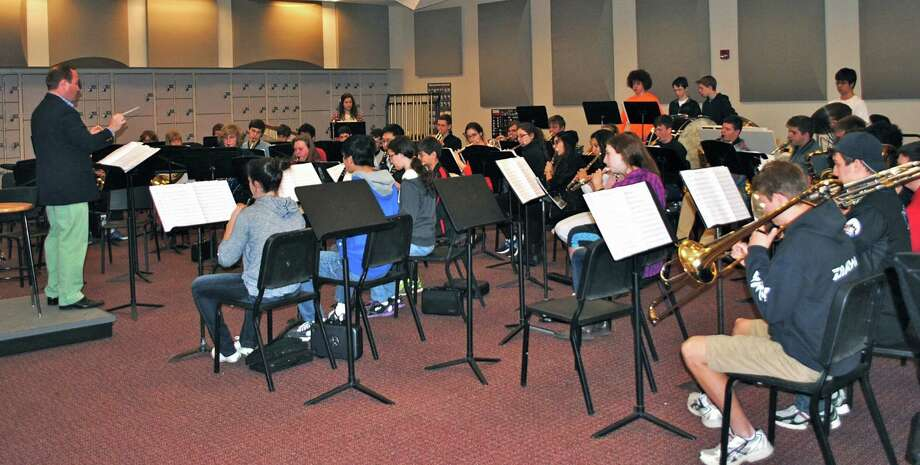 New Canaan High School Band Director Scott Cranston conducts the 50-piece high school band for its upcoming spring concert with the Summer Theatre of New Canaan. Photo: Contributed Photo, Contributed / New Canaan News Contributed